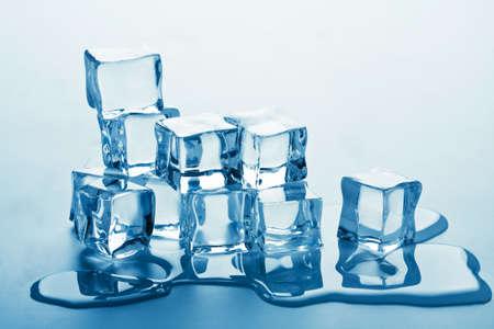 stack of melting ice cubes photo