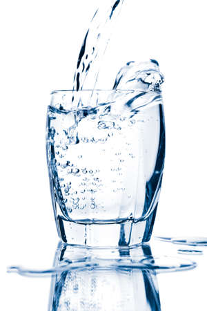 health drink: water splashing into glass isolated