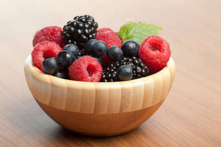 fresh berries in wood bowl Stock Photo - 5498983