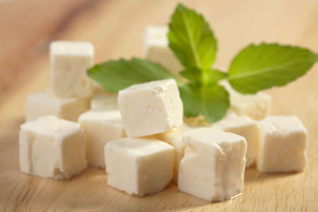 feta cheese on wooden cutting board Stock Photo - 6035635