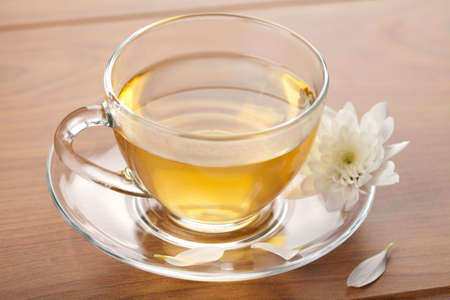 cup of green tea and white flower Stock Photo - 6258280