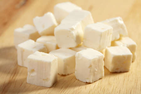 feta cheese on wooden cutting board  photo