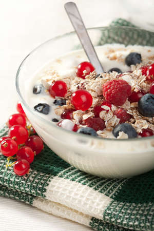 yoghurt with cereal and wild berries  photo