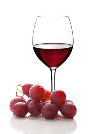 glass of red wine and grapes isolated
