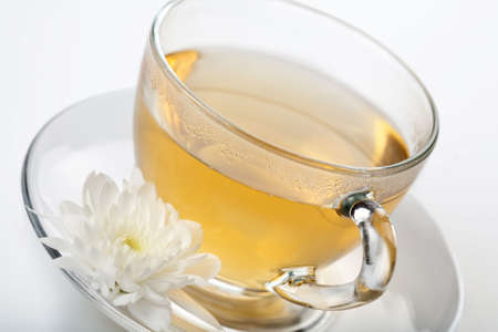 cup of green tea and white flower Stock Photo - 6670565