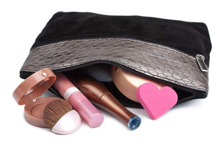 cosmetics collection: black bag with cosmetics isolated Stock Photo
