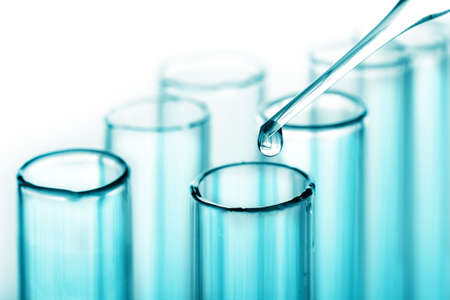 scientific experiment: test tubes and pipette  Stock Photo
