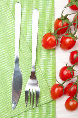 fork knife and tomatoes photo