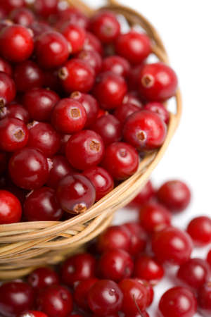 ripe cranberries in bowl isolated  photo