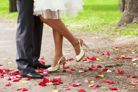 stockings feet: legs over petals  Stock Photo