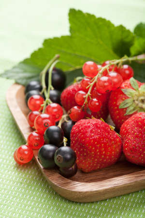fresh berries in wooden bowl  photo