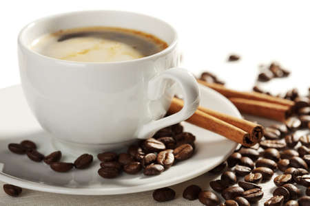 saucer: cup of coffee and roasted beans isolated