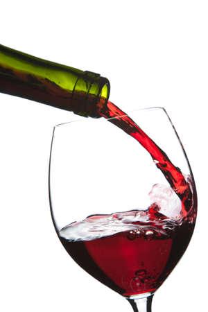 wine pouring: vino rosso, versando in vetro isolato  Archivio Fotografico