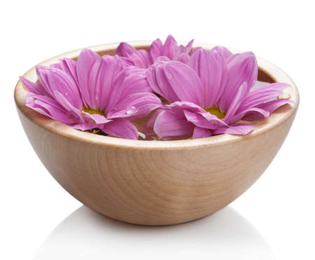wooden aromatherapy: pink flowers in bowl isolated