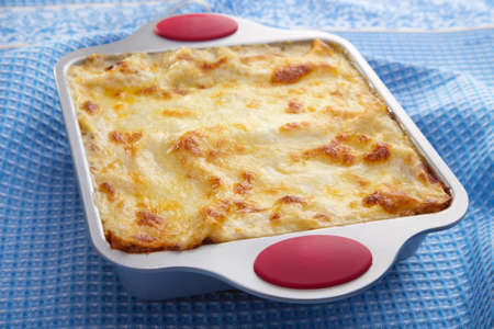 classic lasagna over blue cloth photo