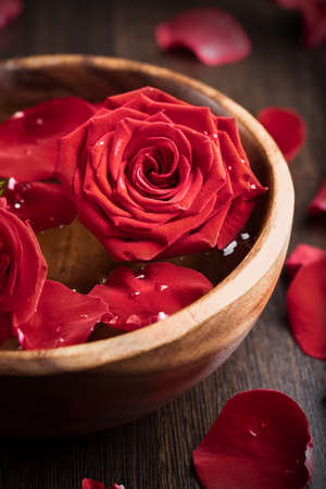 red roses in wooden bowl photo