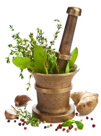 plant medicine: mortar with herbs isolated