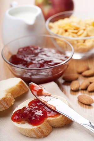 bread with jam for breakfast photo