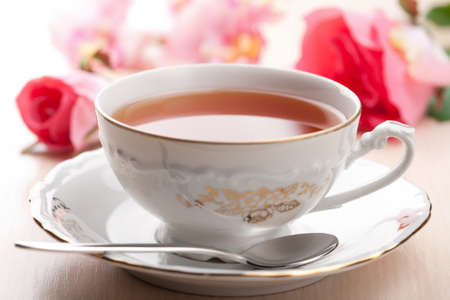 old english: cup of tea and roses Stock Photo