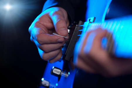 live performance: closeup of guitarist hands