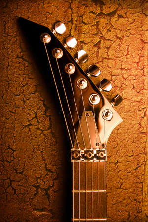 top of guitar over grunge background photo