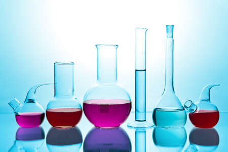 laboratory glassware with colorful chemicals photo