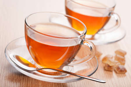 tannin: fresh tea and cane sugar Stock Photo
