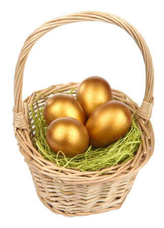 golden easter eggs in  basket isolated Stock Photo - 9151473