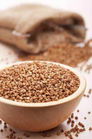 raw buckwheat in bowl  photo