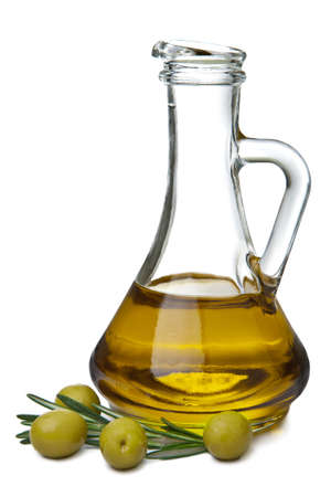 extra virgin olive oil: olive oil in bottle and olives isolated Stock Photo