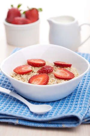 porridge with fresh strawberry photo
