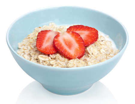 cereal bowl: porridge with fresh strawberry isolated Stock Photo