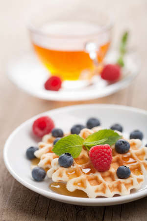 waffles with fresh berries and honey  photo