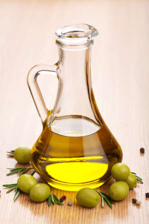 green bottle: olive oil and olives