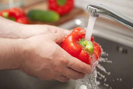 man washing vegetable photo