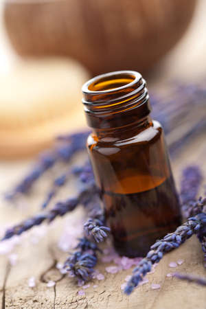 aromatherapy oils: essential oil and lavender flowers