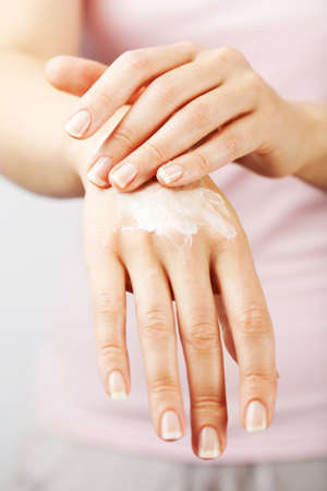 handcare: beautiful woman hands with cream