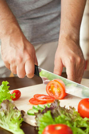 slicing: man cutting vegetables