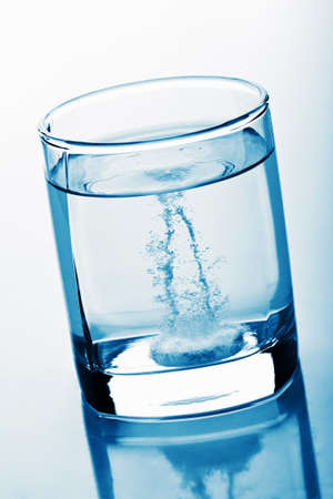 aspirin: tablet in glass of water Stock Photo
