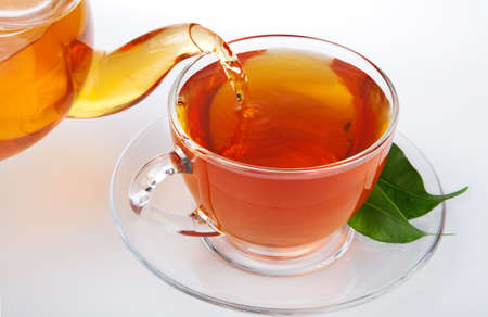 tea pouring into cup photo