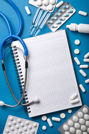 medical background with notebook Stock Photo - 12446906