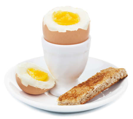 eggcup: boiled egg in eggcup isolated Stock Photo
