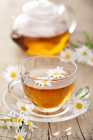 chamomile tea: cup of herbal tea with chamomile flowers