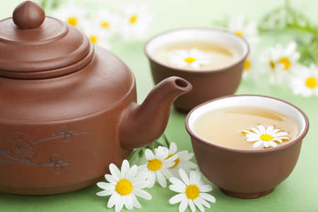 green tea with chamomile flowers  photo