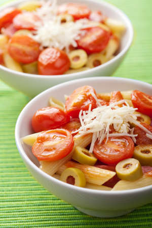 pasta with tomatoes and salami photo