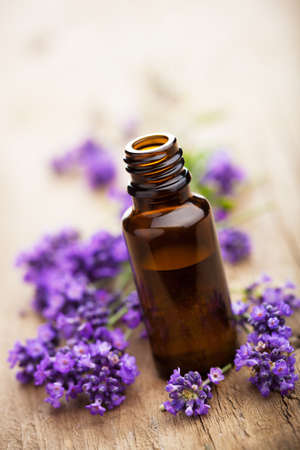 wooden aromatherapy: essential oil and lavender flowers