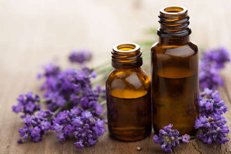 aromatherapy: essential oil and lavender flowers
