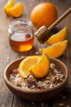 muesli with oranges and honey photo