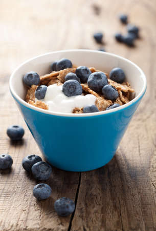 cornflakes with blueberry and yogurt photo