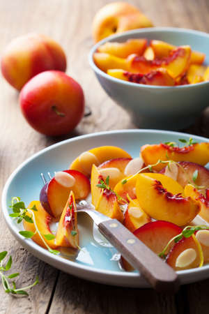 nectarines and plums in syrup  photo